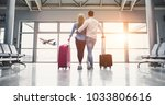 romantic couple in airport.... | Shutterstock . vector #1033806616