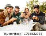 group of four friends having...   Shutterstock . vector #1033822798