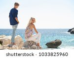 mother and son on cliff... | Shutterstock . vector #1033825960