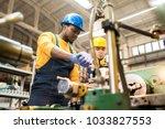multi ethnic team of workers... | Shutterstock . vector #1033827553