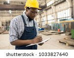 concentrated young technician... | Shutterstock . vector #1033827640