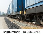 train wheels on tracks with... | Shutterstock . vector #1033833340