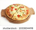 delicious veg cheese pizza on... | Shutterstock . vector #1033834498