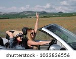 girl driving a convertible car... | Shutterstock . vector #1033836556