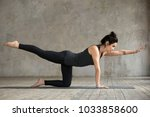 young woman practicing yoga ... | Shutterstock . vector #1033858600