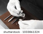 jeweler evaluating ring with... | Shutterstock . vector #1033861324