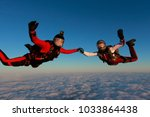 two skydivers are in the winter ... | Shutterstock . vector #1033864438