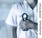 medical man with stethoscope | Shutterstock . vector #1033874164