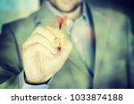 business man with darts | Shutterstock . vector #1033874188