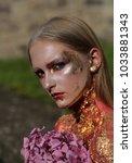 halloween woman with flowers ... | Shutterstock . vector #1033881343
