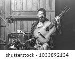 bearded man hipster biker... | Shutterstock . vector #1033892134
