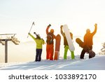 group of four happy skiers and... | Shutterstock . vector #1033892170