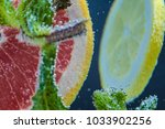 grapefruit  lemon  mint under... | Shutterstock . vector #1033902256