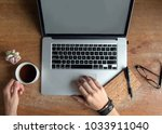 Small photo of Vintage but modern author and writer, wooden laptop on desk. Male hands using a laptop and holding a cup of coffee. such scenes are good for authors, writers, editors or journalists