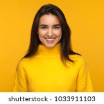 beautiful brunette in yellow... | Shutterstock . vector #1033911103