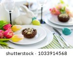 beautiful table setting with... | Shutterstock . vector #1033914568