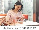 digital technology. cheerful... | Shutterstock . vector #1033925149