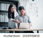 couple working with laptop... | Shutterstock . vector #1033930810