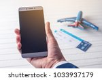 the hand holding the phone with ... | Shutterstock . vector #1033937179