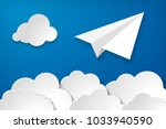 white paper aplane with clouds... | Shutterstock .eps vector #1033940590