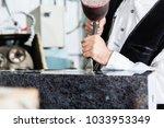 stone mason working on... | Shutterstock . vector #1033953349