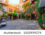 old courtyard in rome  italy.... | Shutterstock . vector #1033959274