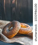 fresh bagel with poppy seed on... | Shutterstock . vector #1033986100