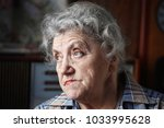 sad and thoughtful elder woman... | Shutterstock . vector #1033995628