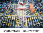 people and taxi cabs crossing a ... | Shutterstock . vector #1033996984