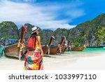 summer lifestyle traveler woman ... | Shutterstock . vector #1033997110