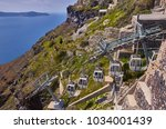 fira town on santorini island ... | Shutterstock . vector #1034001439