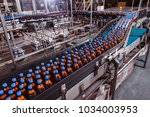conveyor belt with plastic... | Shutterstock . vector #1034003953