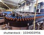 conveyor belt with plastic...   Shutterstock . vector #1034003956