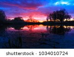 spring sunset above the lake | Shutterstock . vector #1034010724