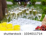 stuffed glasses with champagne... | Shutterstock . vector #1034011714