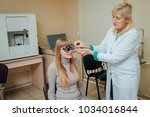 Small photo of Trial frame. Glasses for a young woman. Hypermetropia. Ametropia correction with glasses.