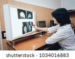 doctor examine mammography test.... | Shutterstock . vector #1034016883