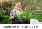 portrait of smiling woman... | Shutterstock . vector #1034017549