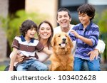 Stock photo family outdoors with a dog looking very happy 103402628