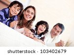 happy family enjoying their... | Shutterstock . vector #103402679