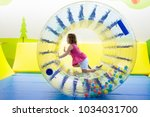 child in roller wheel jumping... | Shutterstock . vector #1034031700