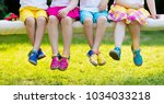 Small photo of Footwear for children. Group of preschool kids wearing colorful leather shoes. Sandal summer shoe for young child and baby. Preschooler playing outdoor. Child clothing, foot wear and fashion.