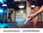 closeup of weightlifter... | Shutterstock . vector #1034040064