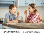 joking. cute happy little dark... | Shutterstock . vector #1034042533