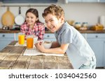 so joyful. handsome delighted... | Shutterstock . vector #1034042560