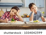 we hate vegetables. attractive... | Shutterstock . vector #1034042599