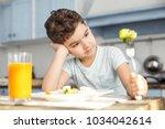 i want candies. handsome sad...   Shutterstock . vector #1034042614