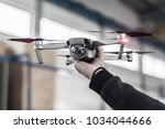 man holding drone before take... | Shutterstock . vector #1034044666