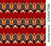 ikat geometric folklore... | Shutterstock .eps vector #1034047588