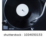 turntable with black record and ... | Shutterstock . vector #1034050153